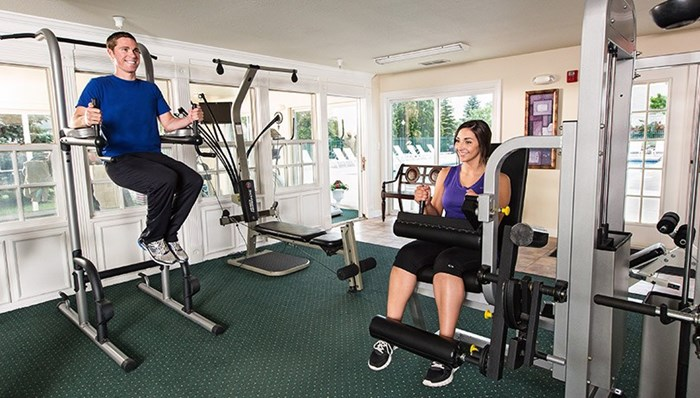 24-hr fitness center with cardio and weight equipment