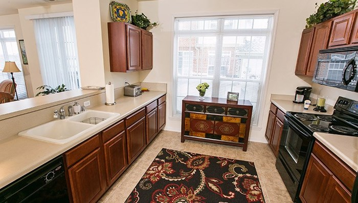 Townhome with bright and airy cook's dream kitchen, high quality cabinetry and ample work space