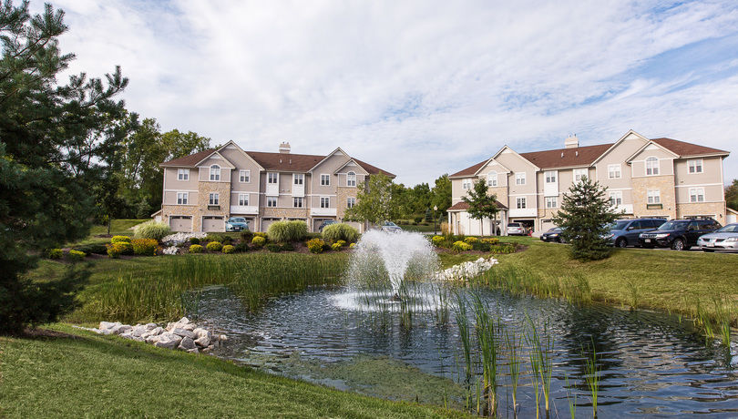 Each Apartment Features A View Of The Pond With The Illuminated Fountain