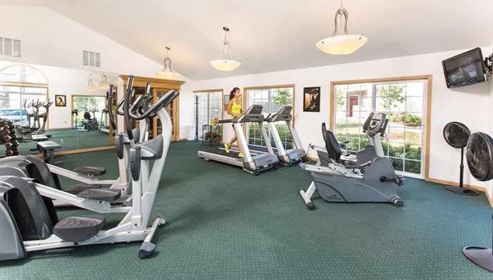 24-hour Fitness Club with aerobic and weight training equipment