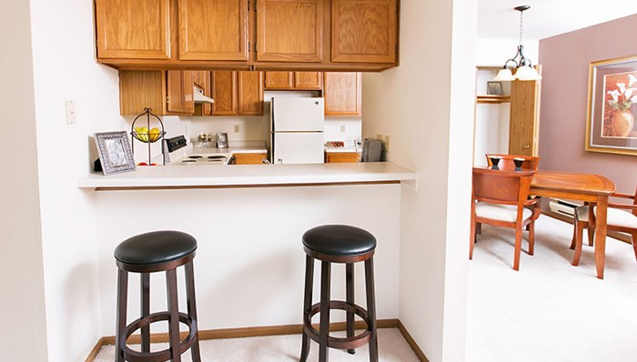 Kitchens with full appliances including dishwasher and garbage disposal, as well as washer/dryer in unit