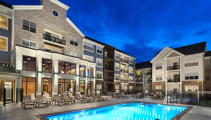 Enjoy the heated pool, sundeck, fire pit and BBQ Central - RiverWalk on the Falls Apartments