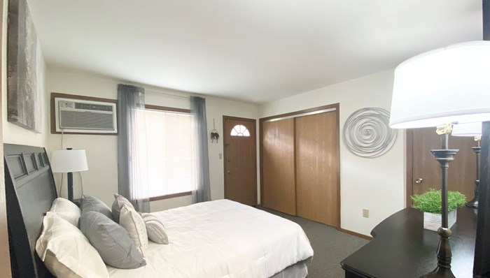 Master bedroom with access to your own outdoor patio in private entry, lower apartments Oakton Beach Apartments