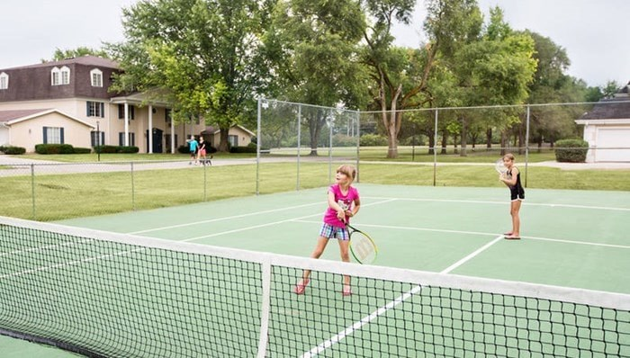 Have fun on the community tennis court Oakton Beach Apartments